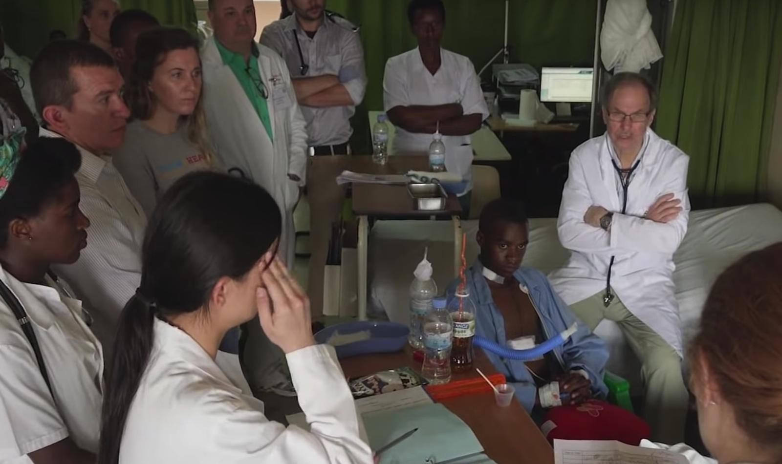 doctors gather around patient